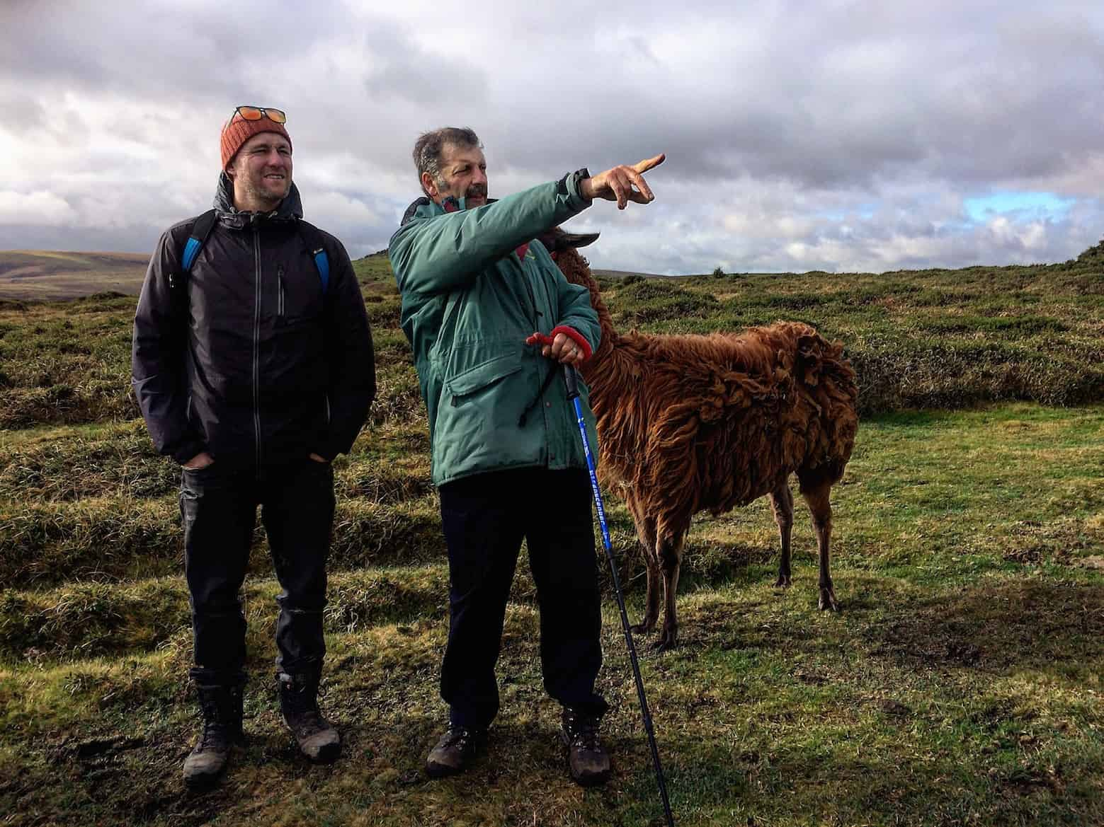 our guide pointing to dartmoor tors
