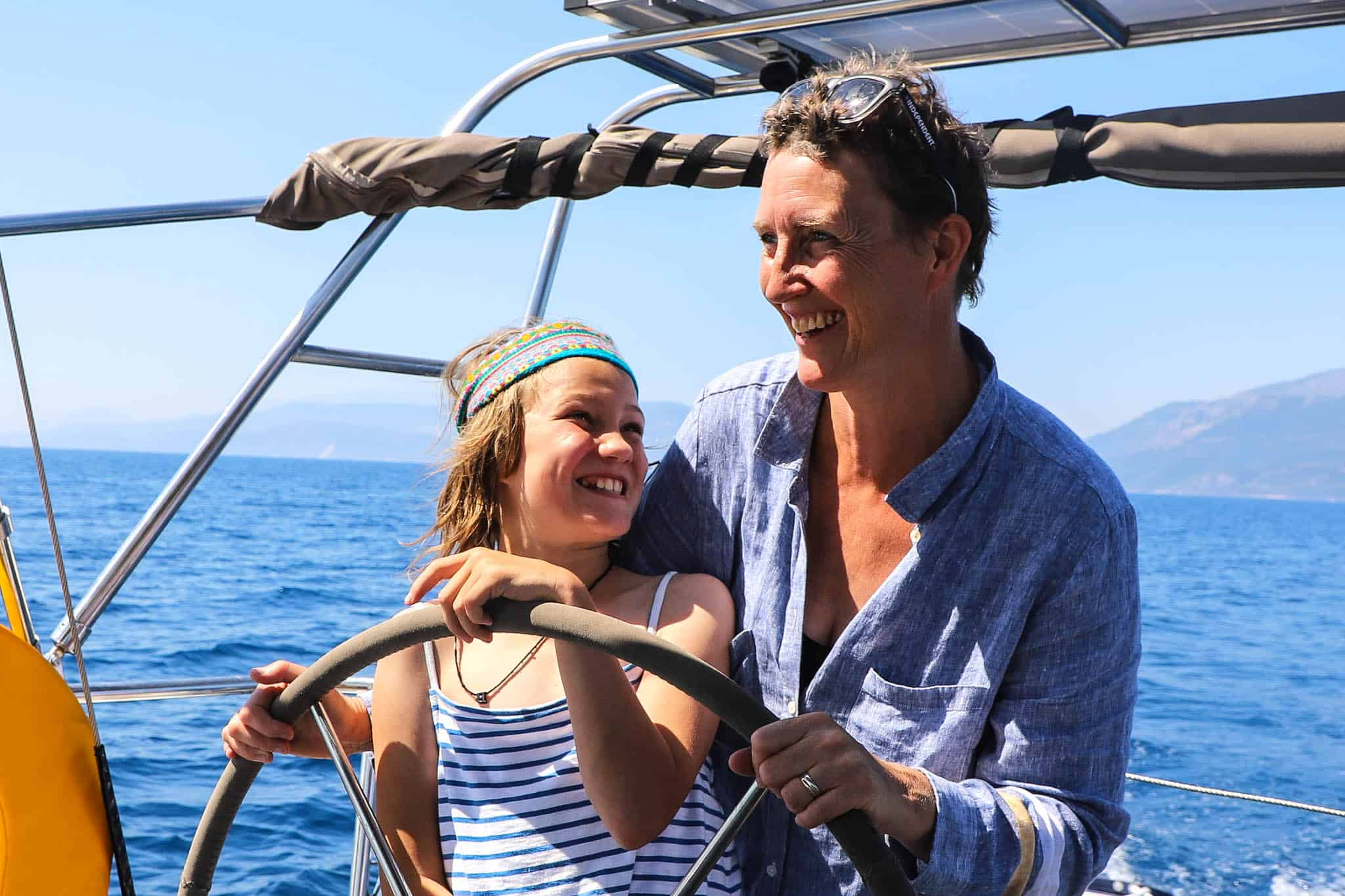 family sailing in greece